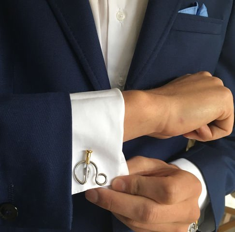 Penny Farthing Cufflinks on white shirt cuff