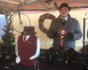 Jamie holding ribbon for 3rd place Best Dressed Stall Stratford-Upon-Avon Christmas Market 2017