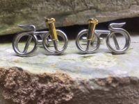 Bicycle cufflinks or downhill bicycle cufflinks on rocks