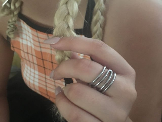 Switchback bike jewellery ring worn on hand holding plait