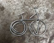 Gifts for cyclists retailers - Bike outline made from leftover bits of bike spokes on steel mottled background
